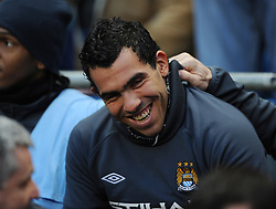 Carlos Tevez on the substitutes bench during the Barclays Premier League match between Manchester City and Aston Villa at the City of Manchester Stadium on December 28, 2010 in Manchester, England.