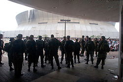 1st Sept, 2005. Mass evacuation of New Orleans begins. Armed soldiers at the Superdome hold back a mass of over 20,000 people desperate to get on busses out of New Orleans.