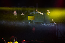 © Licensed to London News Pictures . 01/07/2017 . Manchester , UK . Graeme Park and Mike Pickering . Hacienda Classical play at the Castlefield Bowl as part of Sounds of the City , during the Manchester International Festival . A collaboration between DJs Mike Pickering and Graeme Park and the Manchester Camerata orchestra , Hacienda Classical reworks music by bands including the Happy Mondays and New Order and features Manchester musicians including Rowetta and Peter Hook . Photo credit : Joel Goodman/LNP