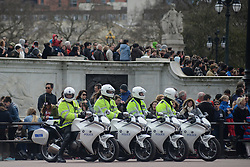 © Licensed to London News Pictures. 18/04/2013. London, UK. Motorcycle police officers at Buckingham Palace, the location for the London Marathon finish line, on April 18, 2013 in London. The London Marathon will be held on Sunday April 21. Photo credit : Peter Kollanyi/LNP