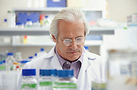 Scientist looking down in laboratory