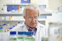 Scientist looking down in laboratory