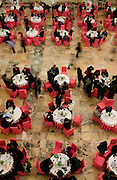 Delegates sit at tables and drink tea inside the Great Hall of the People during the opening of the Chinese People's Political Consultative Conference (CPPCC) in Beijing, China, on Saturday, March 3, 2007. China will enact laws this year aimed at improving the living standards of its 800 million rural people and ensuring equitable public services, according to the chairman of a legislative body.
