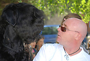 Man with his dog bullet a black russian terrier Model and property release available The Dog won the Bulgarian National Dog Competition on August 28th 2008
