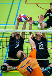 28-04-2018 NED: NK Zitvolleybal, Koog aan de Zaan<br /> BVC Holyoke wint de finale van het NK zitvolleybal met 3-1 van V.a.s. F.D.S uit Sneek. / Dominik Albrecht #6 of Holyoke, Willem Siepel #7 of Sneek, Jacob Hoeksma #12 of Sneek