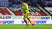 Blackpool Keeper Dean Lyness celebrates during the Sky Bet League 1 match between Wigan Athletic and Blackpool at the DW Stadium, Wigan, England on 12 December 2015. Photo by Pete Burns.