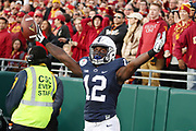 Penn State Nittany Lions wide receiver Chris Godwin (12) waves his arms in celebration after catching a 30 yard touchdown pass that cuts the USC Trojans second quarter lead to 20-14 during the 2017 NCAA Rose Bowl college football game against the USC Trojans, Monday, Jan. 2, 2017 in Pasadena, Calif. The Trojans won the game 52-49. (©Paul Anthony Spinelli)