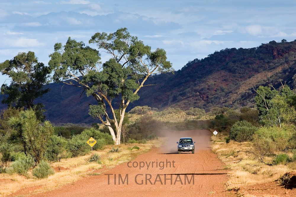 Four-wheel-drive vehicle on the Mereenie Loop Road, Red Centre, Australia