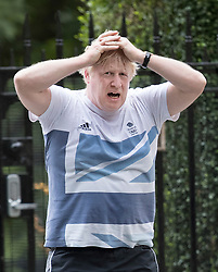 © Licensed to London News Pictures. 12/06/2017. London, UK. Foreign Secretary Boris Johnson returns home from an early morning run in Westminster London. Over the weekend British prime minister Theresa May formed a new cabinet and continues discussions with the DUP in an attempt to form a new government. Photo credit: Peter Macdiarmid/LNP
