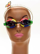 funny portrait of a mannequin head with goggles and butterfly metal hair band