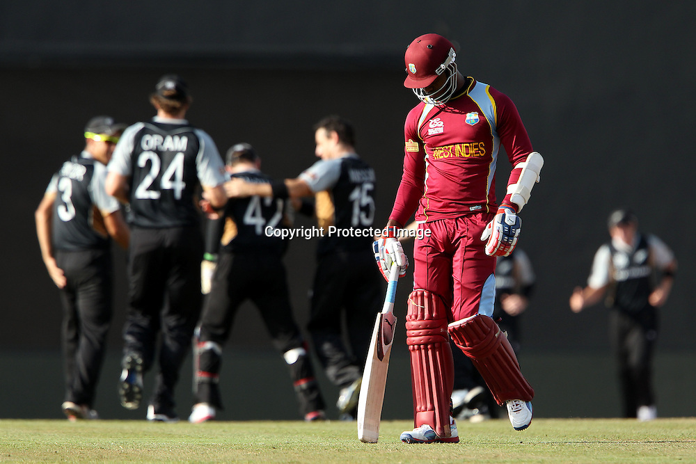 Marlon Samuels of The West Indies departs as New Zealand celebrate his wicket during the ICC World Twenty20 Super Eights match between The West Indies and New Zealand held at the  Pallekele Stadium in Kandy, Sri Lanka on the 1st October 2012<br /> <br /> Photo by Ron Gaunt/SPORTZPICS/PHOTOSPORT