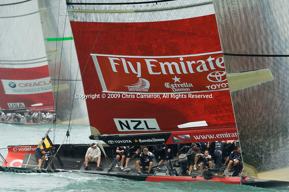 Emirates Team New Zealand on NZL84 to leeward and behind BMW Oracle sailing NZL92 on the first beat of their Round Robin two match. Louis Vuitton Pacific Series. 9/2/2009