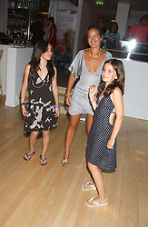 JADE JAGGER and her daughters Left to right, ASSISI and AMBAdancing at party in aid of cancer charity Clic Sargent held at the Sanderson Hotel, Berners Street, London on 4th July 2005.<br />