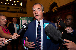 © Licensed to London News Pictures. 27/05/2019. London, UK. British Brexit party leader Nigel Farage speaks to the media at the O2 Guildhall venue before being re-elected at a Member of the European Parliament. 2019.  The Brexit Party is expected to do very well in the elections. Photo credit: Ray Tang/LNP