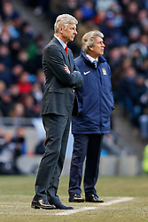 Arsenal Manager Arsene Wenger and Manchester City Manager Manuel Pellegrini look on - Photo mandatory by-line: Rogan Thomson/JMP - 07966 386802 - 18/01/2015 - SPORT - FOOTBALL - Manchester, England - Etihad Stadium - Manchester City v Arsenal - Barclays Premier League.