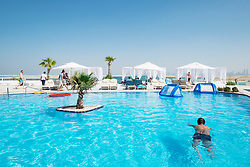 View of The Island Lebanon beach resort on a man made island, part of The World off Dubai coast in  United Arab Emirates