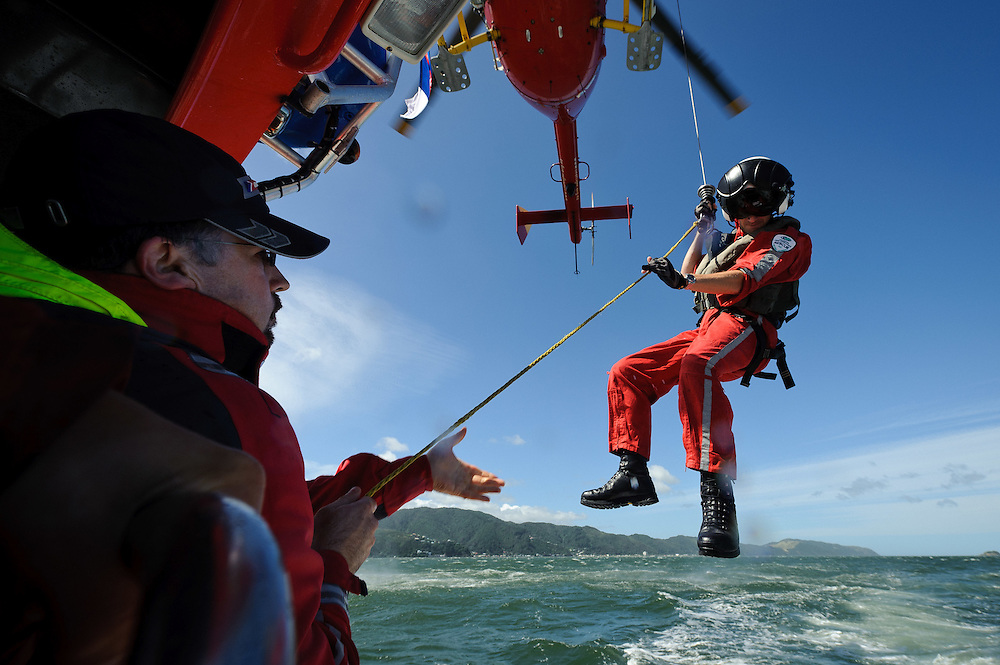 Life Flight Trust editorial coverage. January, 2012. Winch training as shot from the Wellington Coast Guard vessle...Photo by Mark Tantrum | www.marktantrum.com