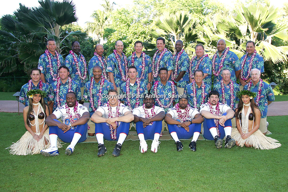 KO OLINA - FEBRUARY 11:  NFC Atlanta Falcons coaching staff (including head coach Jim Mora, top row, 5th from left), Atlanta Falcons 2005 NFL Pro Bowl All-Stars (bottom row left to right: Alge Crumpler #83, Patrick Kerney #97, Michael Vick #7, Allen Rossum #20, Keith Brooking #56), and Hawaiian Hula girls pose for their 2005 NFL Pro Bowl team photo on February 11, 2005 in Ko Olina, Hawaii. ©Paul Anthony Spinelli