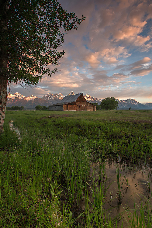Storm clouds build over the picturesque T.A. Moulton barn in Grand Teton National Park.