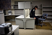 Former vice detective Lt. Pam Seyffert poses for a portrait at her old desk on the special investigations floor of the Sacramento Police Department which was emptied due to budget cuts, and its detectives reassigned to patrol units, October 26, 2012 in Sacramento, Calif.