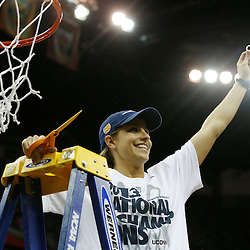 Apr 9, 2013; New Orleans, LA, USA; Connecticut Huskies guard Caroline Doty (5) celebrates after cutting the net after the championship game in the 2013 NCAA womens Final Four against the Louisville Cardinals at the New Orleans Arena. Connecticut defeated Louisville 93-60. Mandatory Credit: Derick E. Hingle-USA TODAY Sports