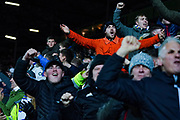 Leeds United fans celebrate Leeds United defender Gjanni Alioski (10) scoring a goal to make the score 2-0 during the EFL Sky Bet Championship match between Leeds United and Hull City at Elland Road, Leeds, England on 10 December 2019.