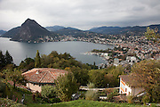 "Lugano, Switzerland on Lake Lugano.""Lugano is a city in the south of Switzerland, in the Italian-speaking canton of Ticino, which borders Italy. The population of the city proper was 55,151 as of December 2011, and the population of the urban agglomeration was over 145,000. Wikipedia"""
