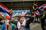 "14 JANUARY 2014 - BANGKOK, THAILAND:  Anti-government protestors in front of Royal Thai Police headquarters. Hundreds of protestors picketed police headquarters because they accuse the police of siding with the government during the protests. Tens of thousands of Thai anti-government protestors continued to block the streets of Bangkok Tuesday to shut down the Thai capitol. The protest, ""Shutdown Bangkok,"" is expected to last at least a week. Shutdown Bangkok is organized by People's Democratic Reform Committee (PRDC). It's a continuation of protests that started in early November. There have been shootings almost every night at different protests sites around Bangkok, but so far Shutdown Bangkok has been peaceful. The malls in Bangkok are still open but many other businesses are closed and mass transit is swamped with both protestors and people who had to use mass transit because the roads were blocked.    PHOTO BY JACK KURTZ"