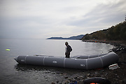 Nov. 16, 2015 - Lesbos, Greece - <br />  A man stands in a inflatable dinghy on the shores of the Greek island of Lesbos on November 16, 2015. Since the start of the summer, the Greek island of Lesbos has assumed notoriety as the main gateway into Europe for thousands of desperate refugees that continue to cross the Aegean sea from Turkey every day.<br /> ©Exclusivepix Media