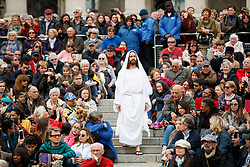 © Licensed to London News Pictures. 14/04/2017. London, UK. Actors of the Wintershall Players perform 'The Passion of Jesus' on Good Friday to crowds in Trafalgar Square, London on 14 April 2017. The Wintershall Players are based on the Wintershall Estate in Surrey and perform several biblical theatrical productions per year. Their production of 'The Passion of Jesus' includes a cast of 80 actors, horses, a donkey and authentic costumes of Roman soldiers in the 12th Legion of the Roman Army. Photo credit: Tolga Akmen/LNP