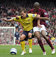 Photo: Ed Godden.<br />Arsenal v Aston Villa. The Barclays Premiership. 01/04/2006. Lee Hendrie (L) is held back by Arsenal's Abou Diaby.