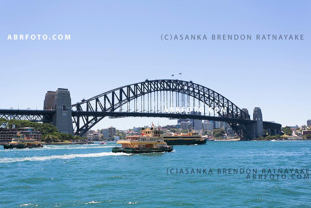 Ferries travel across the Sydney Harbour past the Sydney Harbour Bridge