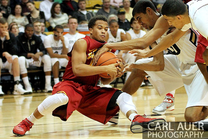January 10th, 2013: University of Southern California Trojans freshman guard Chass Bryan (13) attempts to collect a loose ball from Colorado Buffaloes freshman forward Josh Scott (40) during the NCAA basketball game between the University of Southern California Trojans and the University of Colorado Buffaloes at the Coors Events Center in Boulder CO