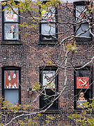 The back of an apartment building to the east of the High Line.  The tenants or owners appear to be unified in their views of President Donald J. Trump
