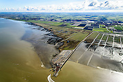 Nederland, Friesland, Gemeente Ferwerderadeel, 28-02-2016; Friesche Wad met kweldergebied en buitendijkse polder van Noorderleeg (Noarderleech) ook Noard-Fryslan Butendyks ter hoogte van Holwerd. Veerdam voor de veerboot naar Ameland.<br /> Landaanwinning door middel van zogenaamde kwelderwerken: vakken begrenst door rijshouten golfbrekers die als gevolg hebben dat het slib kan bezinken. Als de kwelders hoog genoeg groeien er er kwelderplanten.<br /> Land reclamation, Noorderleeg (Northern Void), polder and salt marsh area outside the dikes. The so-called salt marsh works consist of square sections, bordered by brushwood breakwaters causing the sludge to settle.<br /> Causeway for the ferry to Ameland.<br /> luchtfoto (toeslag op standard tarieven);<br /> aerial photo (additional fee required);<br /> copyright foto/photo Siebe Swart