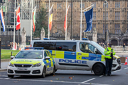 © Licensed to London News Pictures. 03/12/2019. London, UK. Police vans in Parliament Square as Police close roads ahead of the NATO Summit. President Donald Trump arrived in London last night along with 29 World leaders for the NATO summit in Watford. Photo credit: Alex Lentati/LNP