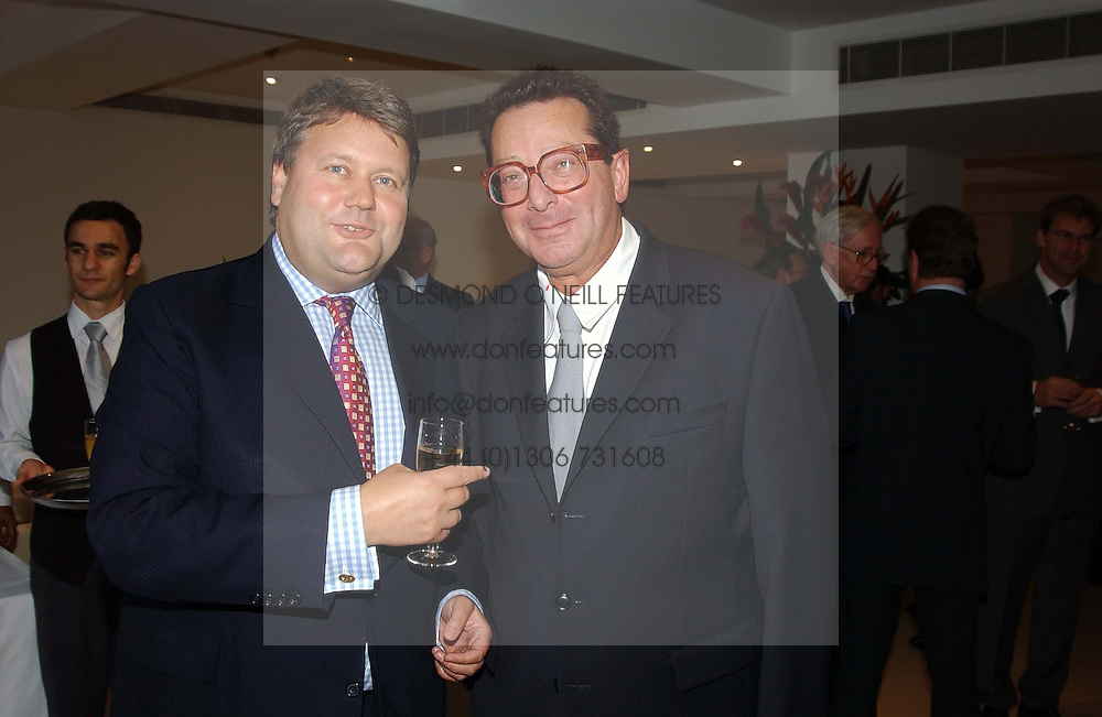 Left to right, LORD STRATHCLYDE and LORD SAATCHI at the Conservative party Pre-Conference Season party hosted by Lord Saatchi and Lord Strathclyde and held at M&C Saatchi, 36 Golden Square, London W1 on 7th September 2004.