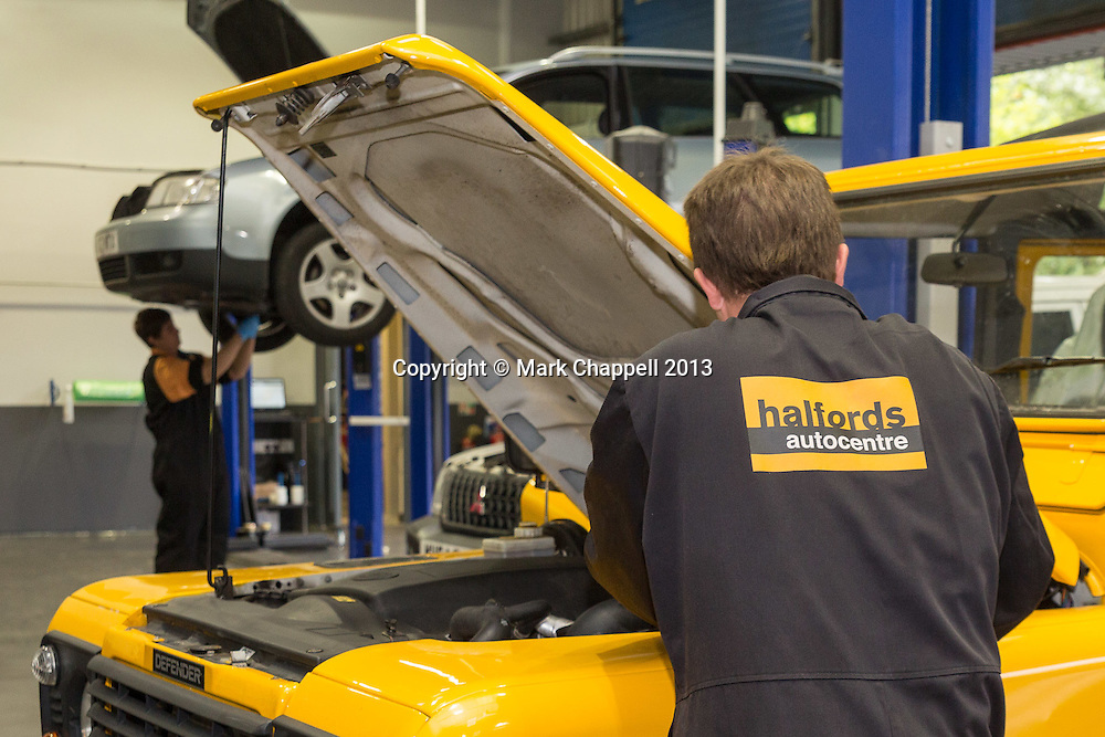 The newly opened branch of Halfords Autocentres in Trowbridge . Wednesday 28  August  2013.  Trowbridge, UK.<br /> Photo Credit: Mark Chappell/Dobson Agency<br /> &copy; Mark Chappell/Dobson Agency 2013.