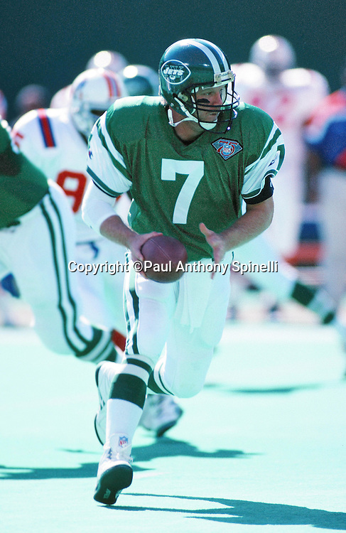 New York Jets quarterback Boomer Esiason (7) looks to hand off the ball on a running play during the NFL football game against the New England Patriots on Oct. 16, 1994 in East Rutherford, N.J. The Jets won the game 24-17. (©Paul Anthony Spinelli)