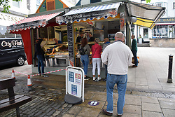 Social distancing measures in operation in Norwich market during Coronavirus lockdown, UK June 2020. Fish stall