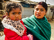 01 MARCH 2017 - KHOKANA, NEPAL: A woman and her child in an informal IDP camp in Khokana. Their home was destroyed in the 2015 earthquake. Recovery seems to have barely begun nearly two years after the earthquake of 25 April 2015 that devastated Nepal. In some villages in the Kathmandu valley workers are working by hand to remove ruble and dig out destroyed buildings. About 9,000 people were killed and another 22,000 injured by the earthquake. The epicenter of the earthquake was east of the Gorka district.     PHOTO BY JACK KURTZ