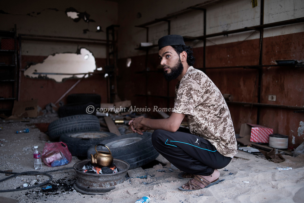 Libya: A Libya's Government of National Accord's (GNA) fighter makes tea for the Iftar (evening meal that breaks the fart during the Ramadan). Alessio Romenzi