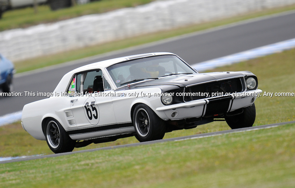 Fraser Ross - Group Nc - Ford Mustang.Historic Motorsport Racing - Phillip Island Classic.18th March 2011.Phillip Island Racetrack, Phillip Island, Victoria.(C) Joel Strickland Photographics.Use information: This image is intended for Editorial use only (e.g. news or commentary, print or electronic). Any commercial or promotional use requires additional clearance.