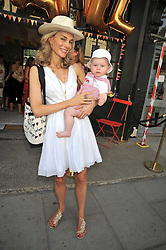 KIM HERSOV and her son AIDAN at the 10th anniversary party of the store Caramel, Ledbury Road, London W11.  The party was held in association with the Naked Heart Foundation - a charity set up by model Natalia Vodianova.