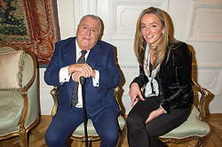 ALBERT ROUX and HANNAH GUTTERIDGE at a reception in honour of Anna del Conte held at The Italian Emabssy, Grosvenor Square, London on 9th November 2015.