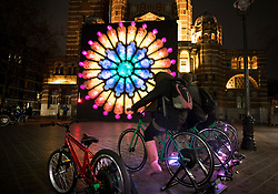 © Licensed to London News Pictures. 17/01/2018. London, UK. A bicycle powered illuminated installation entitled 'The Rose' by Mick Stephenson stands in front of Westminster Cathedral during the Lumiere London festival. Running from 18th-21st January 2018 more than 50 artworks are transforming the capital's streets, buildings and public spaces into an immersive nocturnal art exhibition of light and sound. Locations include King's Cross, Fitzrovia, Mayfair, West End, Trafalgar Square, Westminster, Victoria, South Bank and Waterloo. Photo credit: Peter Macdiarmid/LNP