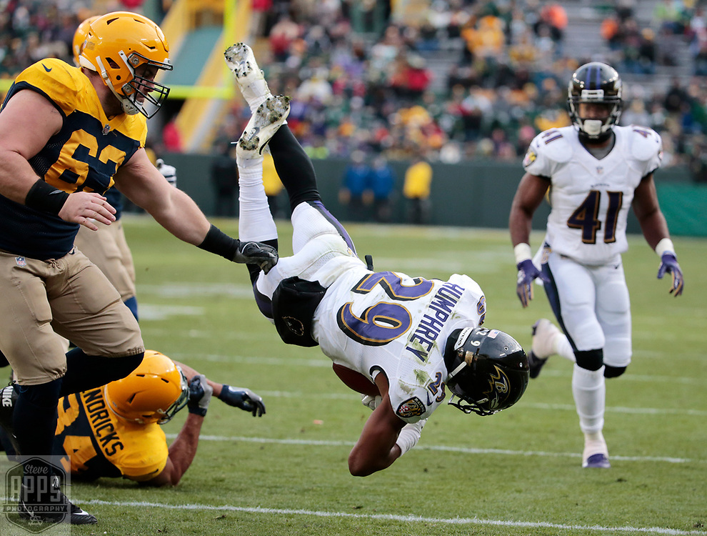 Baltimore Ravens defensive back Marlon Humphrey (29) is tackled by Green Bay Packers tight end Lance Kendricks (84) after intercepting a Green Bay Packers quarterback Brett Hundley (7) pass late in the 4th quarter. Humphrey returned the ball to the Green Bay 3-yard line. <br /> The Green Bay Packers hosted the Baltimore Ravens at Lambeau Field Sunday, Nov. 19, 2017. The Packers lost 23-0. STEVE APPS FOR THE STATE JOURNAL.