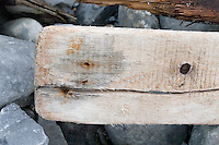 Driftwood plank on rocks on Inis Oirr the Aran Islands Galway Ireland