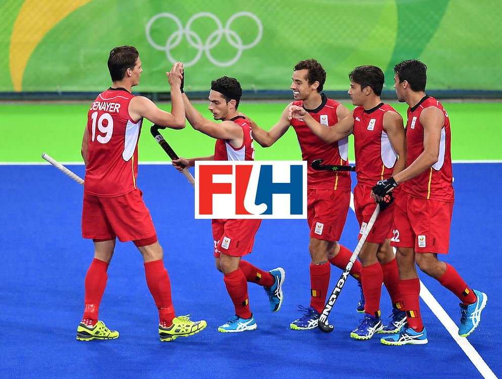 Belgium's Tanguy Cosyns (2nd L) celebrates the opening goal with teammates during the men's Gold medal field hockey Belgium vs Argentina match of the Rio 2016 Olympics Games at the Olympic Hockey Centre in Rio de Janeiro on August 18, 2016. / AFP / MANAN VATSYAYANA        (Photo credit should read MANAN VATSYAYANA/AFP/Getty Images)