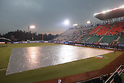 MEXICO CITY - MARCH 12: A large tarp covers the infield as rain begins to fall while Mexico prepares to play Cuba in Pool B, game 6 in the first round of the 2009 World Baseball Classic at Foro Sol Stadium in Mexico City, Mexico, on Thursday March 12, 2009. Cuba got a mercy rule win over Mexico by virtue of a 16-4 score in the seventh inning. (Photo by Paul Spinelli/WBCI/MLB Photos)